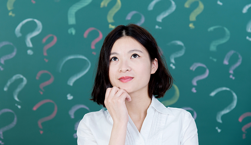 A woman with question marks surrounding her