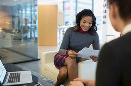 Image of a woman interviewing another woman with an application.