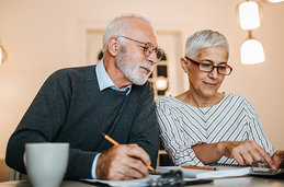 An older couple calculating their finances