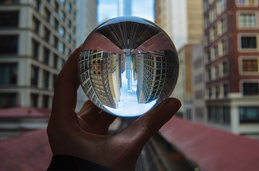 Photo of a hand holding a crystal ball