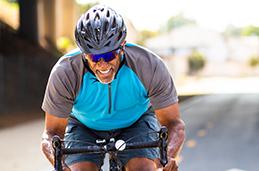 Photo of a man riding a bike