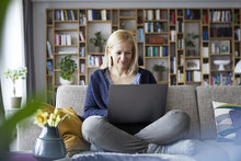 Woman on sofa with laptop