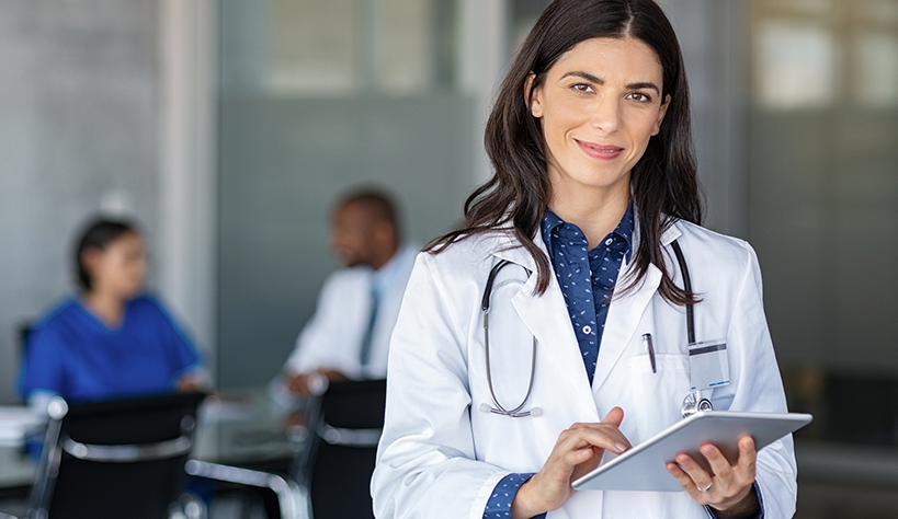 Doctor Holding Tablet