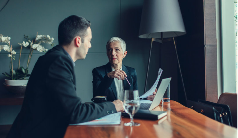 Image of two people having a meeting