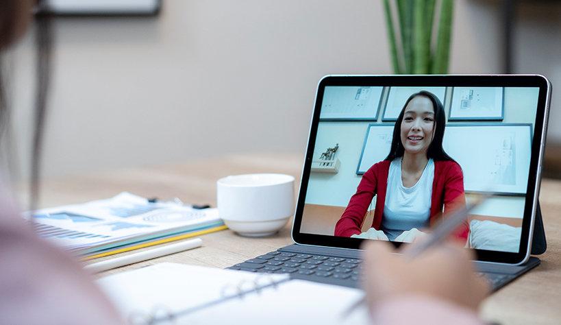 A woman on a laptop screen