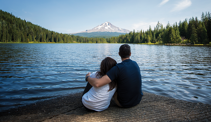 Photo of a couple looking at Mt. Hood