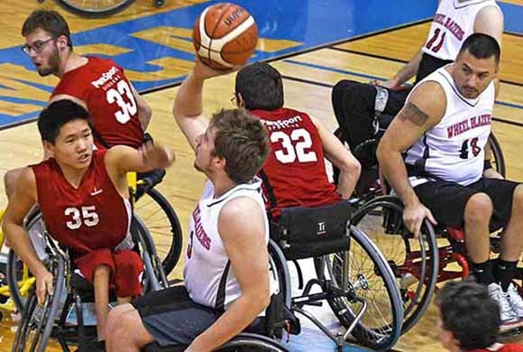 Photo of men in wheelchairs playing basketball