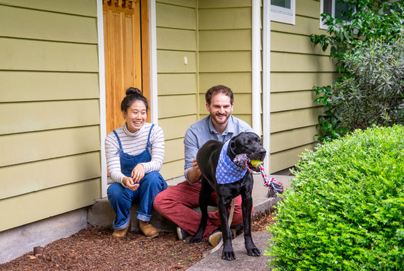 Photo of a couple with their dog