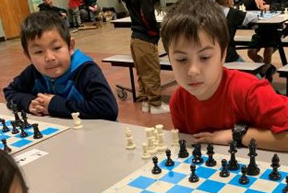 Photo of a boy playing chess
