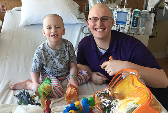 Photo of a boy with toys in the hospital