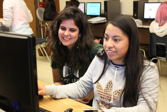 Photo of two students at a computer