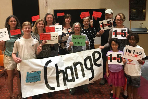 Photo of kids with a Change sign