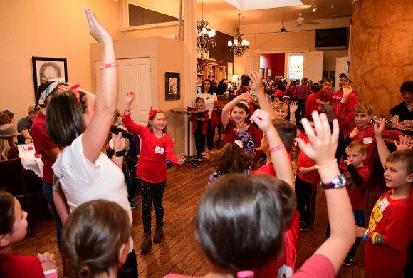 Photo of kids raising their hands