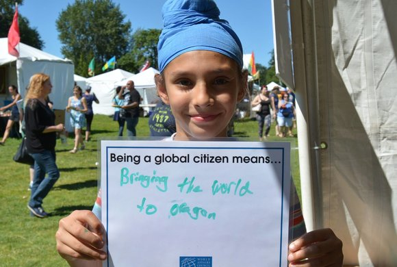 Photo of a girl with a global citizen sign