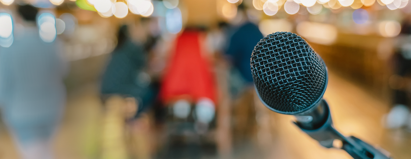 Photo of a microphone at a presentation
