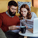 Couple reviewing investments