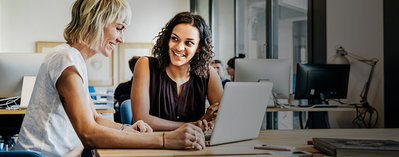 Two women collaborating in an office