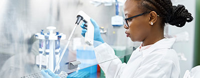 Photo of a woman working in a lab