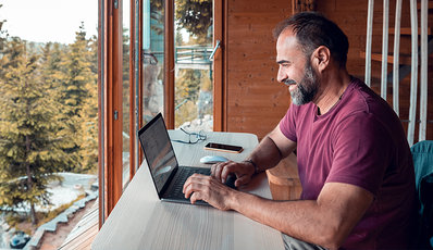 Man working on laptop at his desk